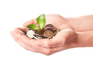 Hands-reaching-out-giving-loan-consolidation-help-to-someone-requiring-debt-relief
